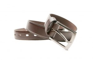 Brown stylish men's belts coiled.